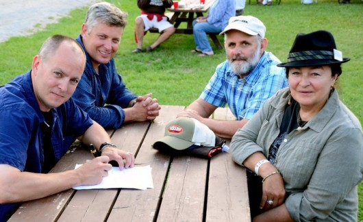 Leigh and Eric Gibson, left, signing their Rounder contract, with 2 of Rounder's founders, Ken Irwin and Marian Levy.